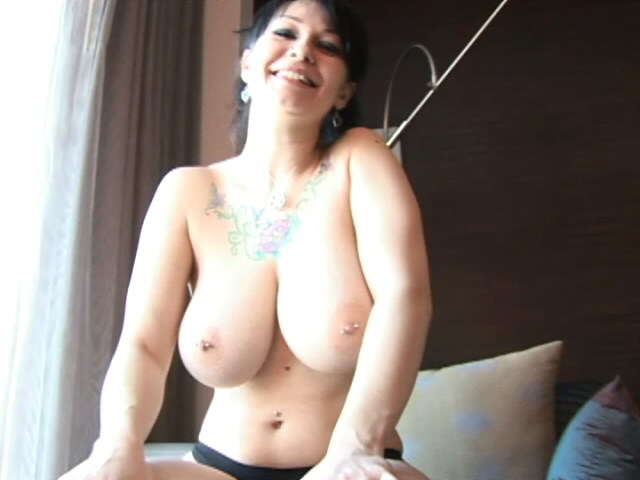 Fleshy Black-haired Teenager Jennique Displaying Her Phat Boobies